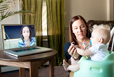 a teleintervention session, a mom with her baby the focus