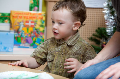 a toddler focusing on a learning project